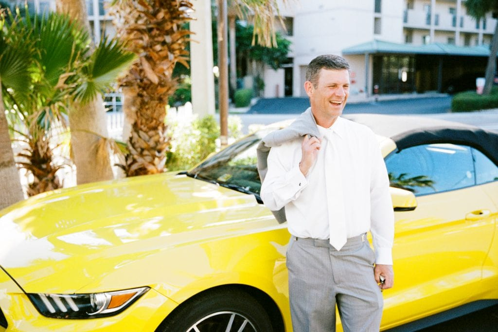 destination wedding video, beach wedding, groom with yellow mustang
