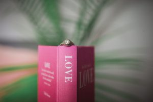 engagement ring on pink love book, wedding anxiety