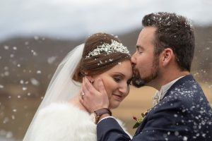 bride and groom kissing in the snow, winter wedding, wv wedding