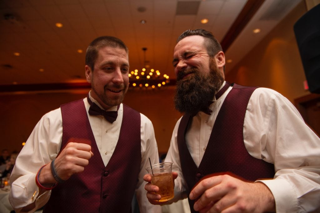 groomsmen singing and dancing with drinks, wv wedding video, wedding reception fun