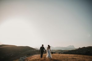 man and woman eloping on mountaintop, coronavirus wedding planning tips. coronavirus wedding video
