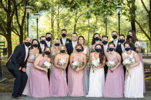 covid19 safe wedding happy wedding party in matching navy face masks for safety