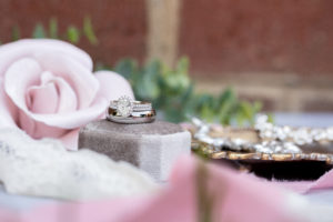 pink wedding details with a diamond ring set